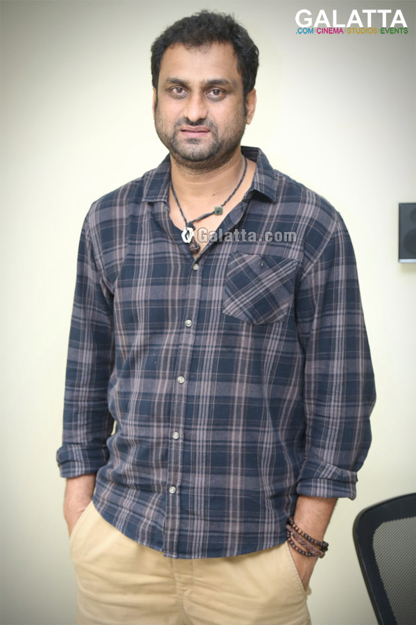 Director Mahi during an interview for Aanando Brahma