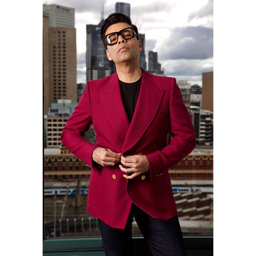 Here we see Karan rocking a double-breasted blazer from Gucci in style