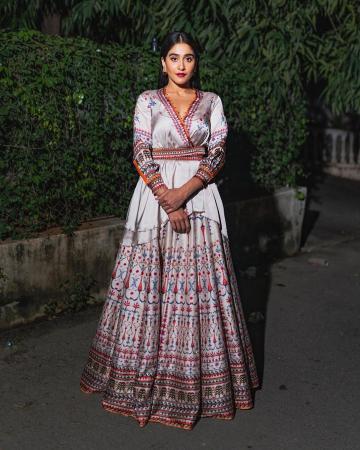 The asymmetrical angraka kurta from Rajdeep Ranawat and the matching skirt has detailed, ethnic multicolour prints - Fashion Models