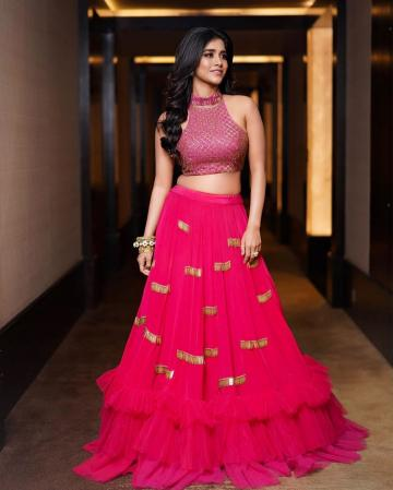 The skirt - bright pink with gold patches has tulle tiers that we don't care much for. The third tier could have been entirely avoided - Fashion Models