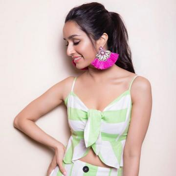 Fuschia tribal cowrie shell earrings from Bansri can add character to any look and here it becomes just the fun element that the outfit needed - Fashion Models