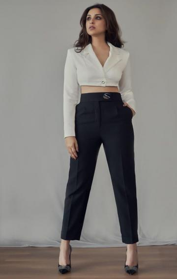 The single button cropped suit and high waist pants give off a boss lady feel that we like