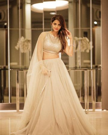 The halter shimmer blouse is great, so is the layered tulle lehenga - Fashion Models
