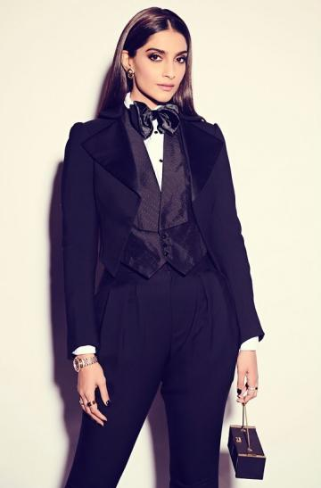 The black suit from Ralph Lauren with triangular lapels and a cute waist coat works for us - Fashion Models