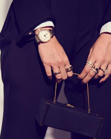 The clutch is a swag number. The watch from IWC Schaffhausen is another fine addition, so are the rings from Diamantina - Fashion Models