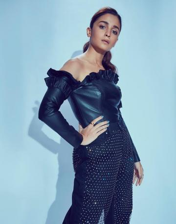 Alia Bhatt graced the Mumbai Film Festival in this off-shoulder leather black outfit from Osman - Fashion Models