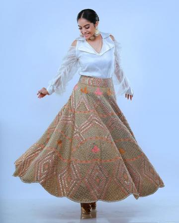 The mirror work lehenga is in beautiful colour; the cold shoulder top has an interesting crunched puff sleeve - Fashion Models