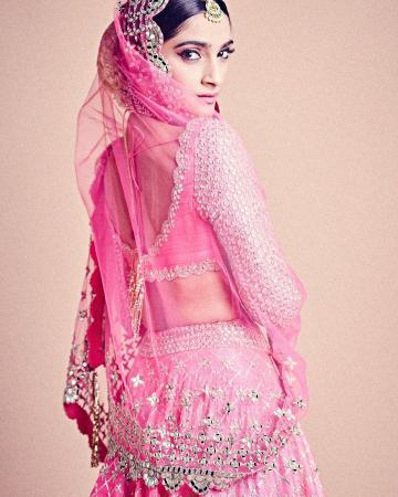 The embroidery on the sleeves is repeated in the shawl and the hemline of the skirt - Fashion Models