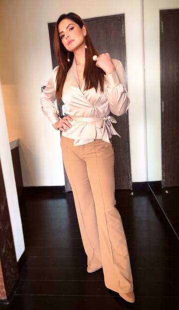 The satin tie top from the store Runway is paired to a good effect with flared pants from Zara - Fashion Models