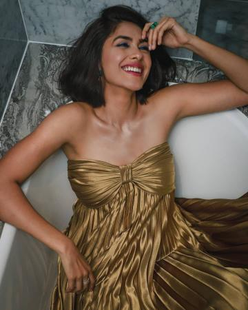 TV sweetheart Mrunal Thakur went to the Gold awards night in a beautiful gold off-shoulder gown from Zwaan - Fashion Models