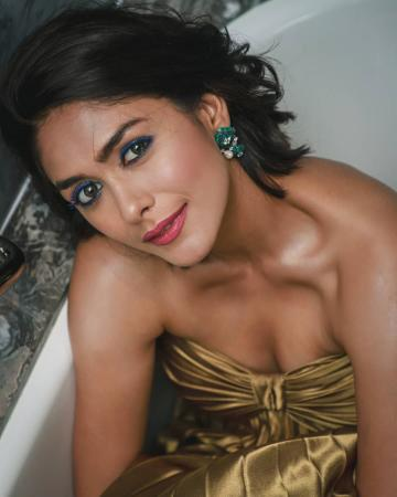 The earrings from Tsara are beautiful; so is Mrunal's makeup scheme with bright electric eye shadow - Fashion Models