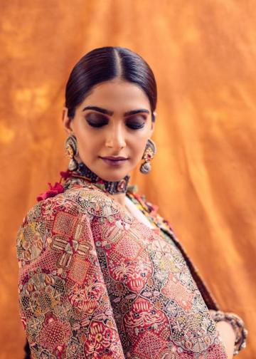We're loving that ethnic carpet-inspired coat which would look at home in a gypsy caravan - Fashion Models