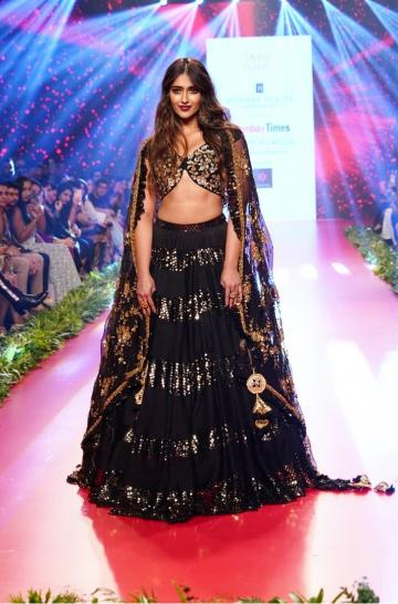 The ornaments and makeup that we see on Ileana is sober so that the charm of the lehenga shines through - Fashion Models