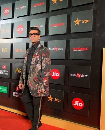 Karan arrived for the Mumbai Film Festival in this colourful suit from Comme des Garcons - Fashion Models