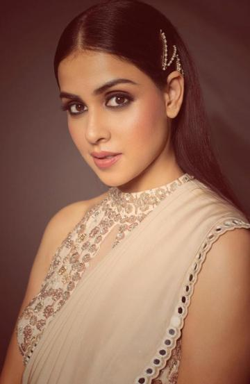 Genelia's make-up is also on point, with accentuated eyes and a subtle blusher that matches the lip colour - Fashion Models