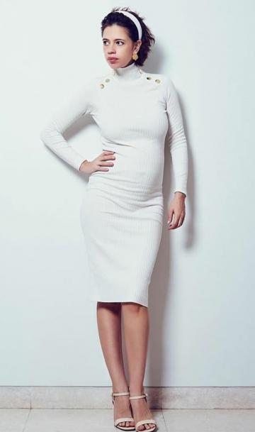 The full sleeve, fitting dress has gold buttons down both shoulders, making it look dignified - Fashion Models