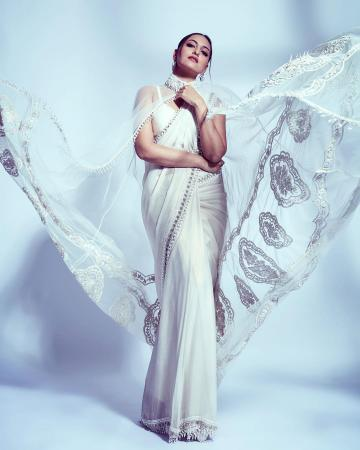 The embroidered cape is the most attractive feature of this sequin-bordered saree ensemble - Fashion Models