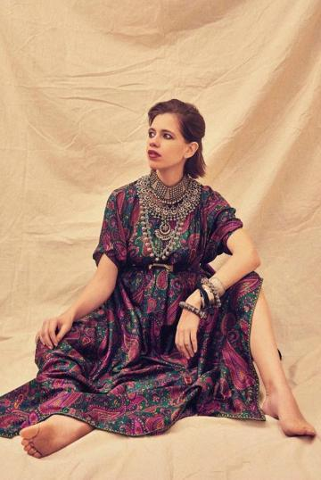 The kaftan is cinched above Kalki's advancing belly using a belt, nearly hiding it - Fashion Models