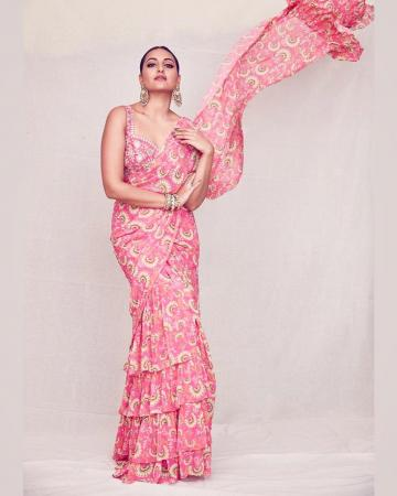 The floral pink saree has charming layers and a ruffled pallu - Fashion Models