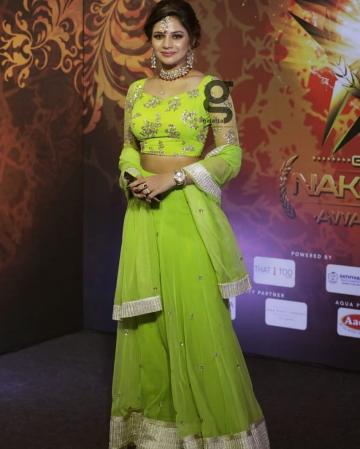 The lehenga skirt has green tulle layers trimmed with silver zari and the top has sequin work - Fashion Models