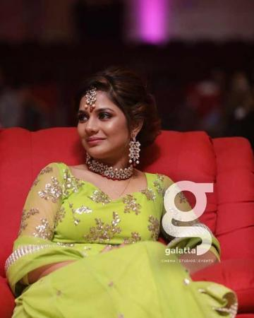 The pretty lady was wearing a red stonework choker dangler and maang teeka set along with an assortment of rings  - Fashion Models
