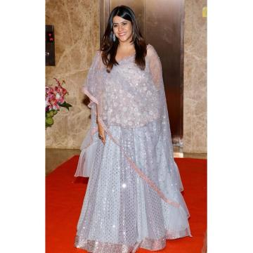 The silver-blue lehenga skirt has detailed mirror work and a baby pink border - Fashion Models