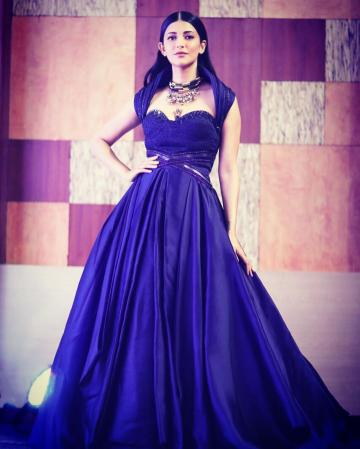 We love the sleeve of the gown which forms an arch around Shruthi's shoulders and the belts at the waist - Fashion Models