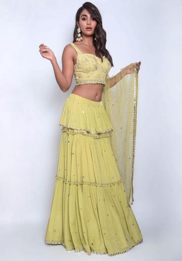 The tiered skirt has mirrors on them and the shawl has matching adornments - Fashion Models
