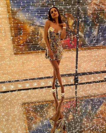 The oh-so-short slip dress from designer Manish Malhotra has twinkling diamond shaped panels that makes her a cute discotheque light - Fashion Models