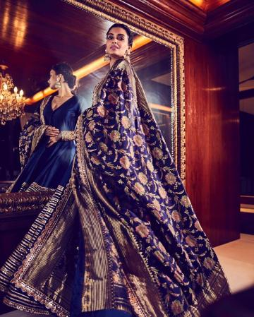She paired it with a statement black shawl with elaborate gold leaf embroidery    - Fashion Models