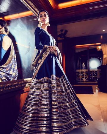 The dress has a thick band of rich embroidery that looks just splendid! - Fashion Models
