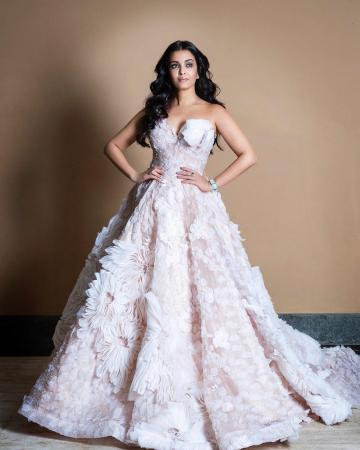 The lady is wearing a light pink, floral lace gown with beadings and 3D organza from the spring-summer 2020 collection of label Nedret Taciroglu - Fashion Models