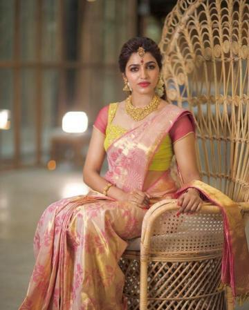 Stylist-designer Swapna Reddy added some green to add relief, but we feel it undermines the beauty of the saree, which has s superior quality of embroidery - Fashion Models