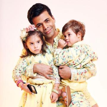 Little Miss Johar has a hairband inspired by the outfit and cute yellow and pink bangles - Fashion Models