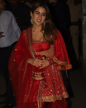 Sara Ali Khan arrived for the Diwali celebrations at Amitabh Bachchan's residence in this lustrous red Anarkali from designers Abu Jani and Sandeep Khosla - Fashion Models