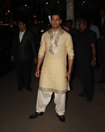 The Kurta has silver and copper metallic work that looks great - Fashion Models