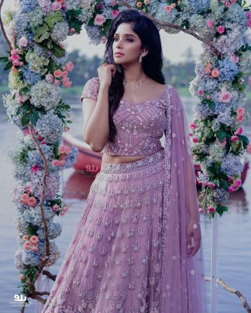We love the beautiful work on the lehenga, complete with little pearls and self-coloured beads - Fashion Models