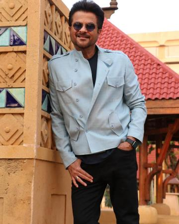 Mr. India, who is busy with the promotion of the movie Pagalpanti, paired it with a black tee and black pants, making the ensemble action-ready - Fashion Models