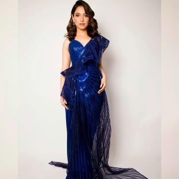 The 3D embossed print with subtle applique has a sheer, wavy side-train that looks chic - Fashion Models