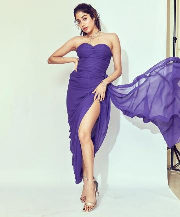 The plain purple gown gathers at the waist forming a drape to one side - Fashion Models