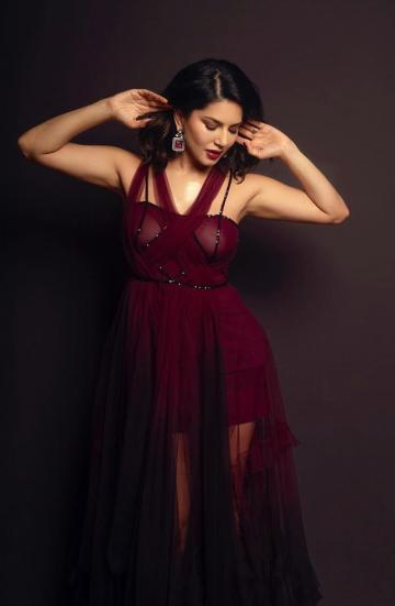We're loving the sequin-lined halter shawl draped bust of the off-shoulder gown - Fashion Models