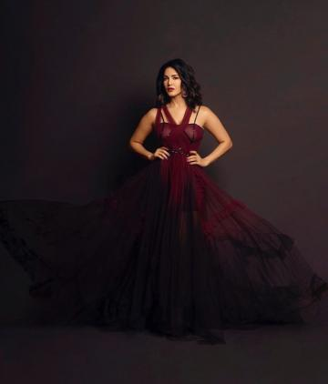 The gown has a beige-maroon layered bust and a full skirt that billows around - Fashion Models