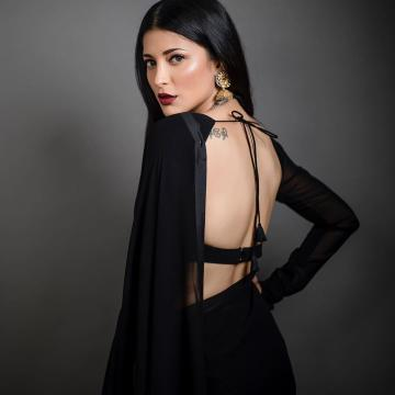 The makeup is goth-inspired and sharpens Shruthi's piercing features even more - Fashion Models