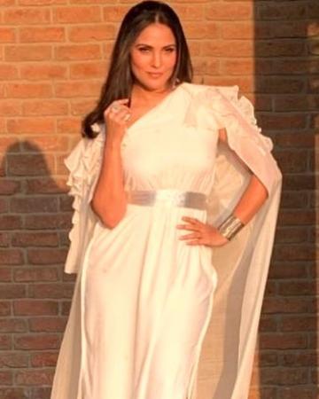 Lara Dutta was looking dazzling in this white otufit from Schulen Fernandes when she arrived for the launch of the seventh edition of Miss Diva  - Fashion Models