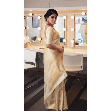 The lady is from kerala and the saree looks like the gold embroidered Kerala saree - Fashion Models