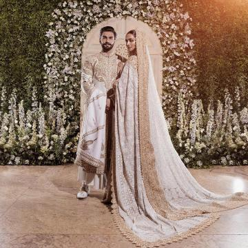 They had a second reception at Grand Hyatt in Mumbai, for which Deepika decked up in a white heavily embroidered saree and matching jewellery from Abu Jani Sandeep Khosla - Fashion Models