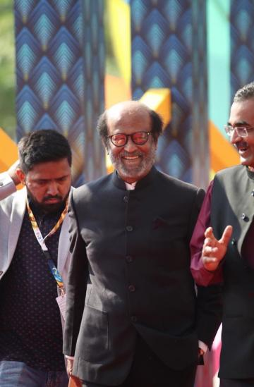 Rajinikanth, named the icon of the IFFI golden jubilee, was wearing a very Indian looking black suit from Herringbone and Sui - Fashion Models