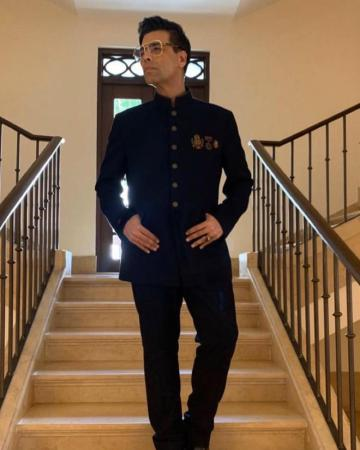 Karan Johar, who is hosting the 2019 International Film Festival of India at Goa, was spotted on day-1 in this dapper suit from Shantanu and Nikhil - Fashion Models
