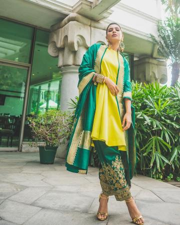 The lady's earrings are from Sheetal Zaveri and the bangle stack from Sachdeva Ritika is a real inspiration - Fashion Models