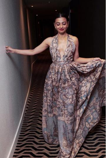 The neckline of the gown is plunging and the print interesting; there is a self-tie on it too - Fashion Models
